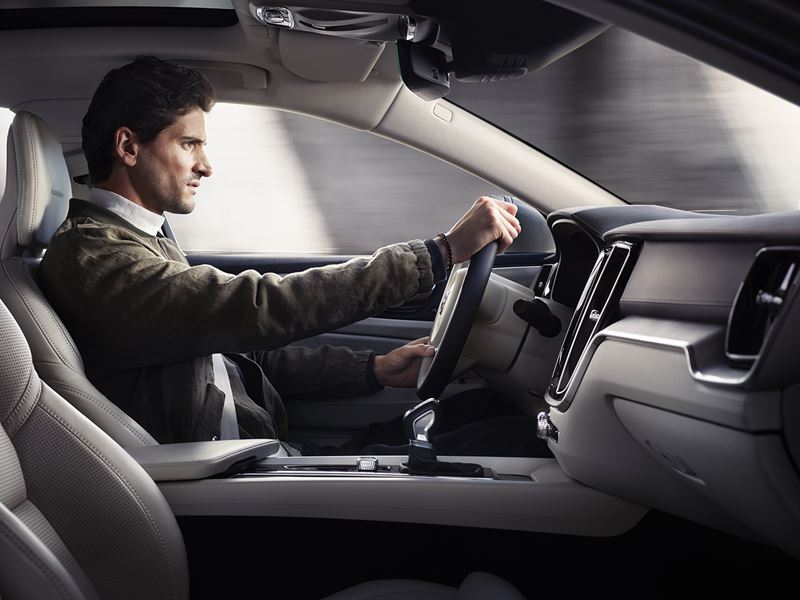man driving a 2019 Volvo s60