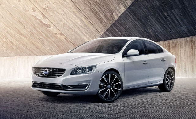 New 2018 Volvo S60 driving along the coast
