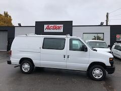 2014 Ford E-150 1/2 ton with shelving, ladder rack and divider. Cargo