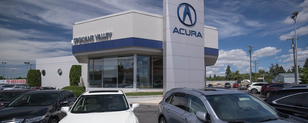Exterior entrance to AutoNation Acura Spokane Valley dealer during the day