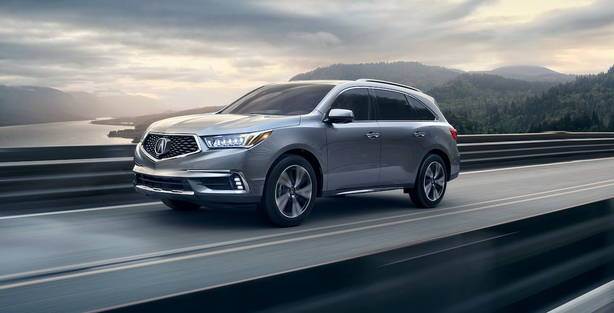 Acura MDX crusing down the road
