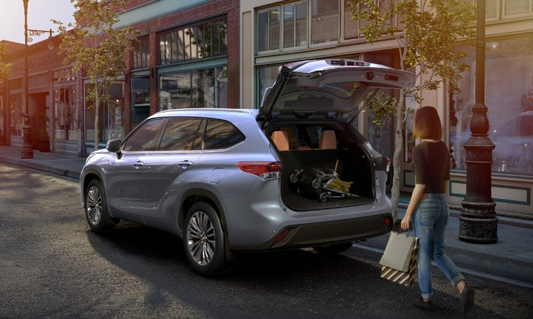 Woman loading trunk of 2020 Toyota Highlander