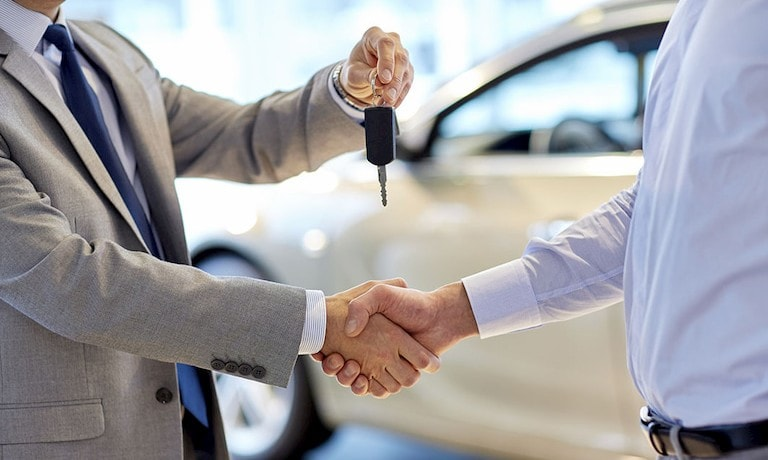 Man giving keys to customer