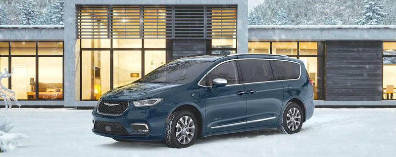 Fathom Blue Chrysler Pacifica parked in the snow