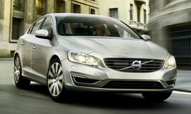 2014 volvo s60 driving through a city