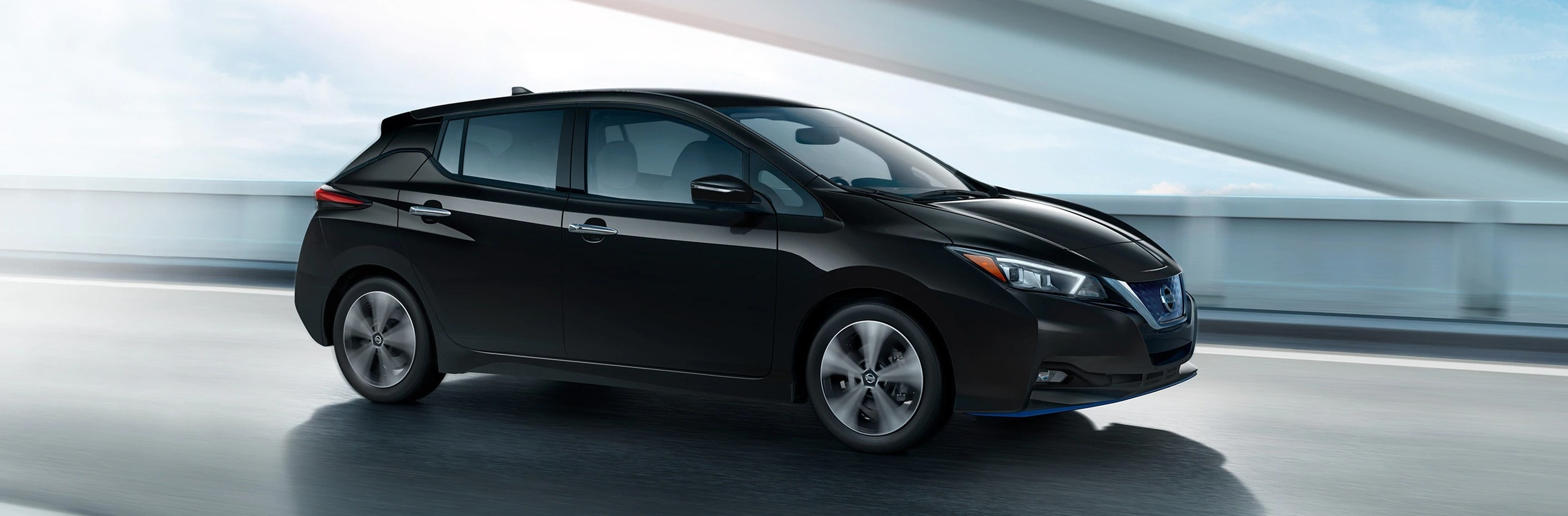 2021 Nissan Leaf exterior driving on a city street