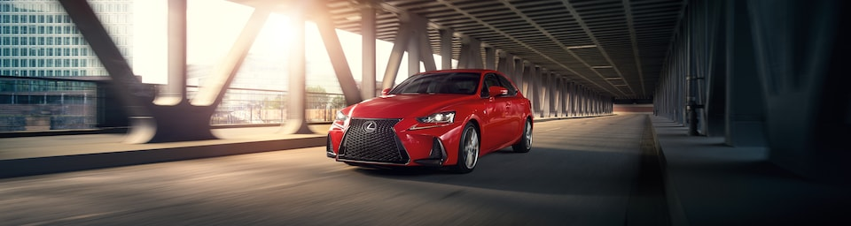 2018 Lexus IS driving down an interstate road