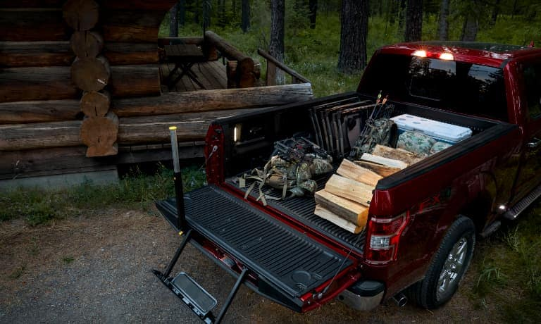 2020 Ford F-150 truck bed open with camping equipment