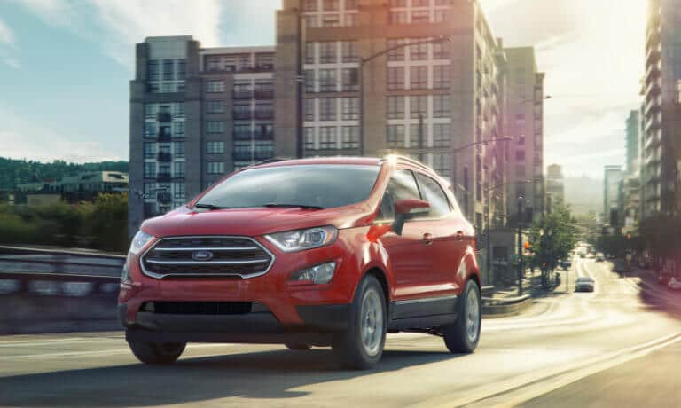 Red 2019 Ford EcoSport driving in city exterior view