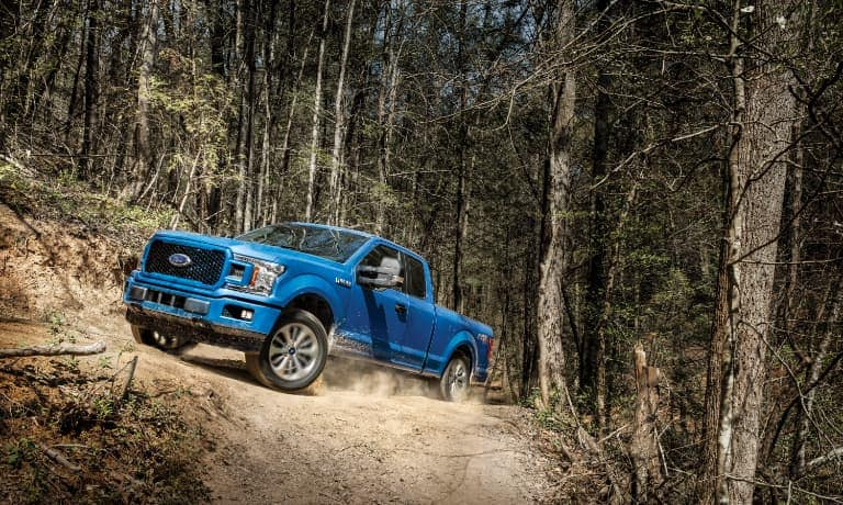 2020 Ford F-150 driving through the woods