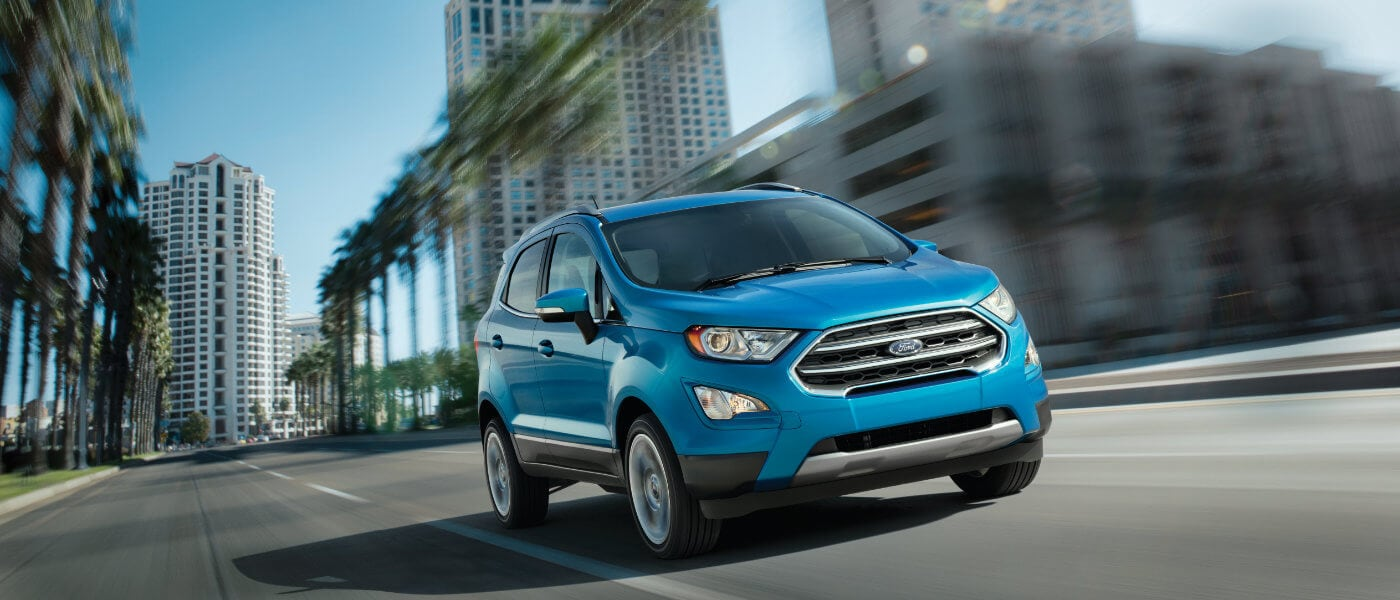 Blue 2019 Ford EcoSport driving through the city