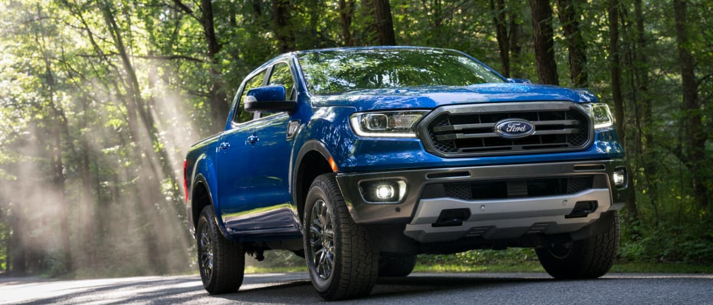 2020 Ford Ranger driving under trees on a road