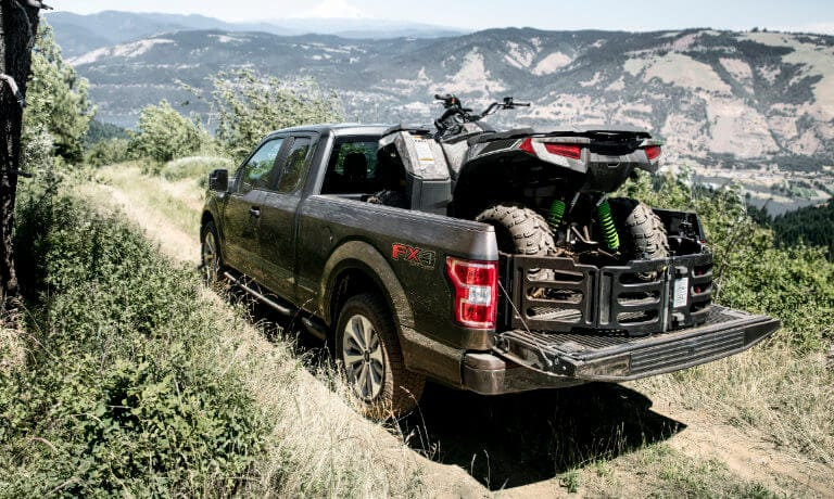 2020 Ford F-150 with an ATV in the truck bed