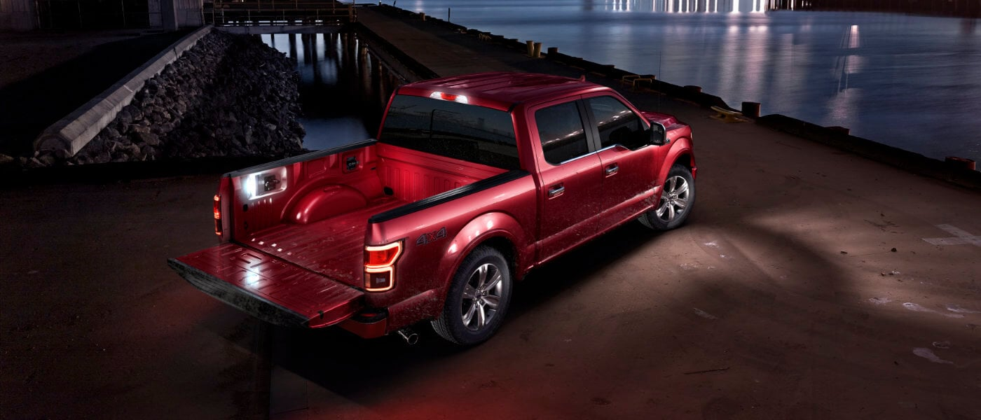 2020 Ford F-150 parked at night by a dock near water