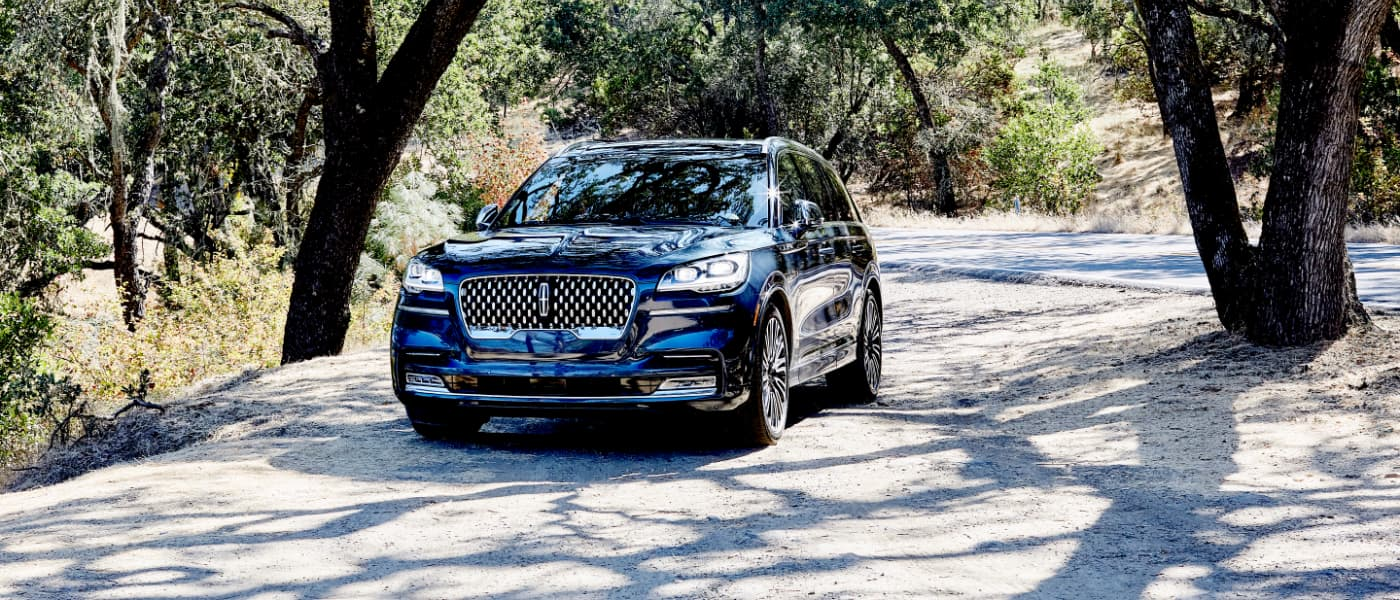 2020 Ford Lincoln Aviator parked outside in woods
