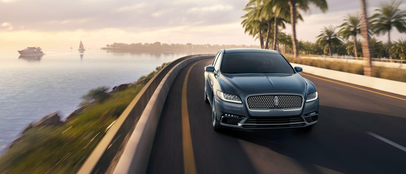 2019 Lincoln Continental driving by ocean