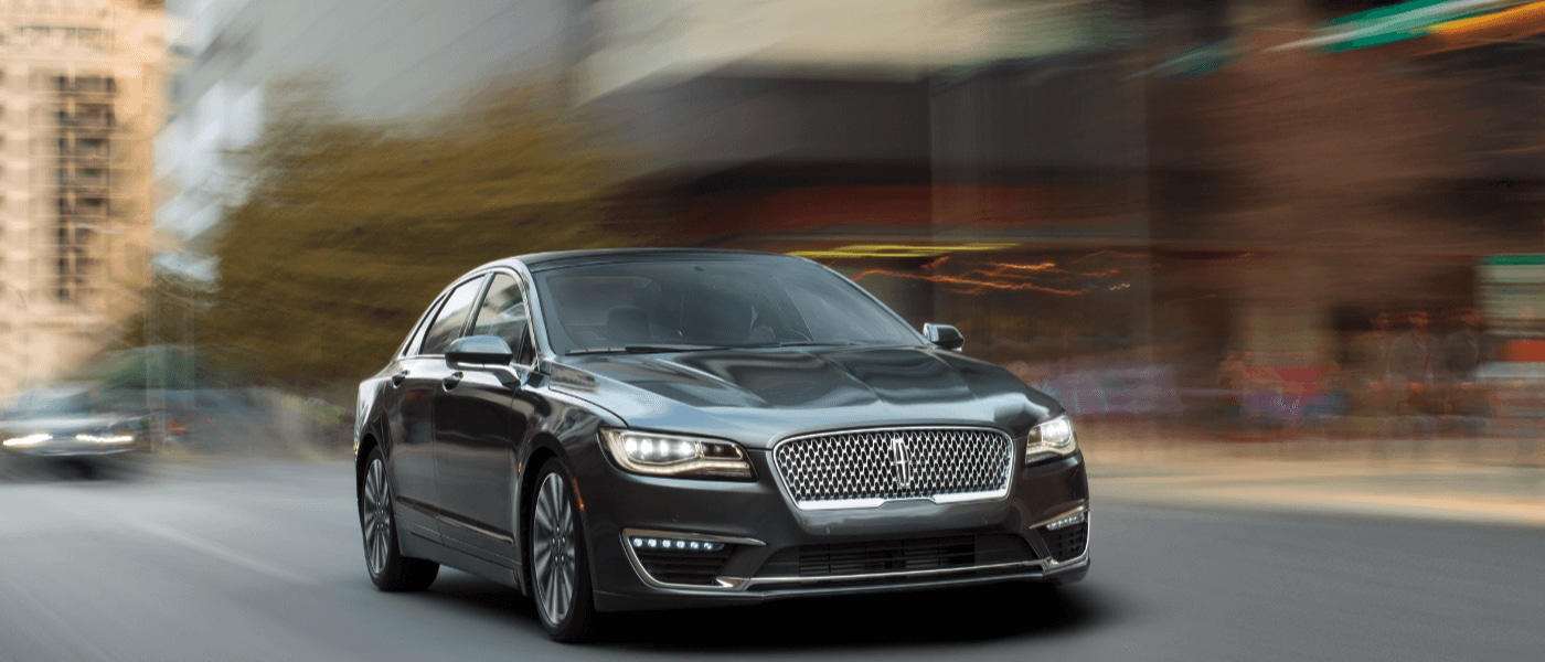 Black 2019 Lincoln MKZ driving front exterior view