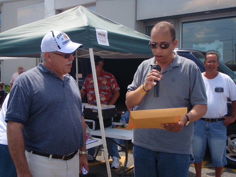 New Bedford Councillor David Alves, presenting Bob Bancroft with another citation from the city for contributing to the community by sponsoring Ashley Ford's 7th Annual Mustang Day Car Show.