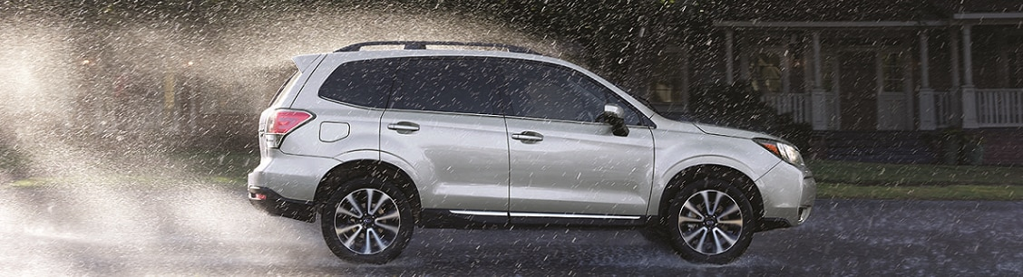 2017 Subaru Forester SUV driving in rain