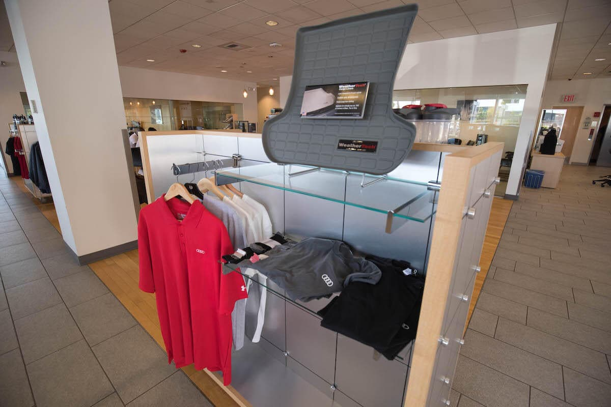 Audi apparel and WeatherTech floor mats at Audi Bellevue