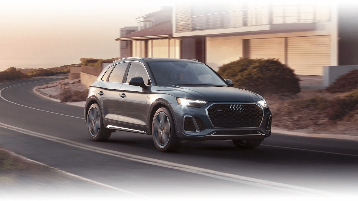 Audi Q5 driving down the road