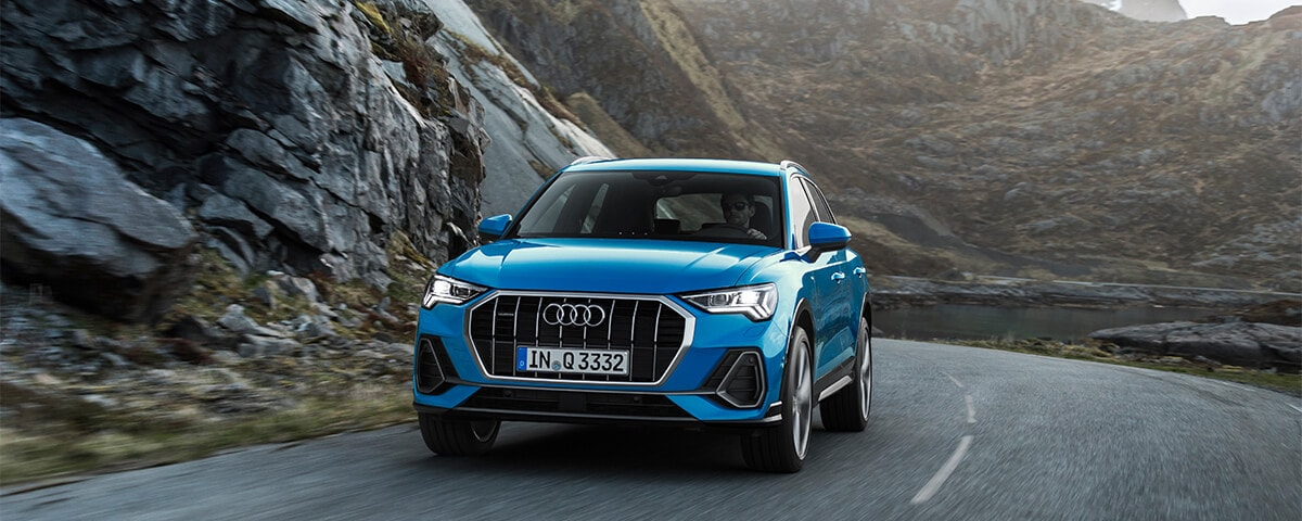Audi Q3 driving down the road