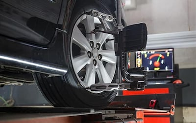 $20 OFF 4 WHEEL ALIGNMENT SERVICE