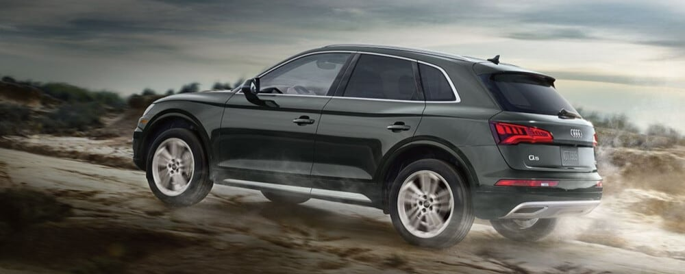 2020 Audi Q5 driving on dirt road