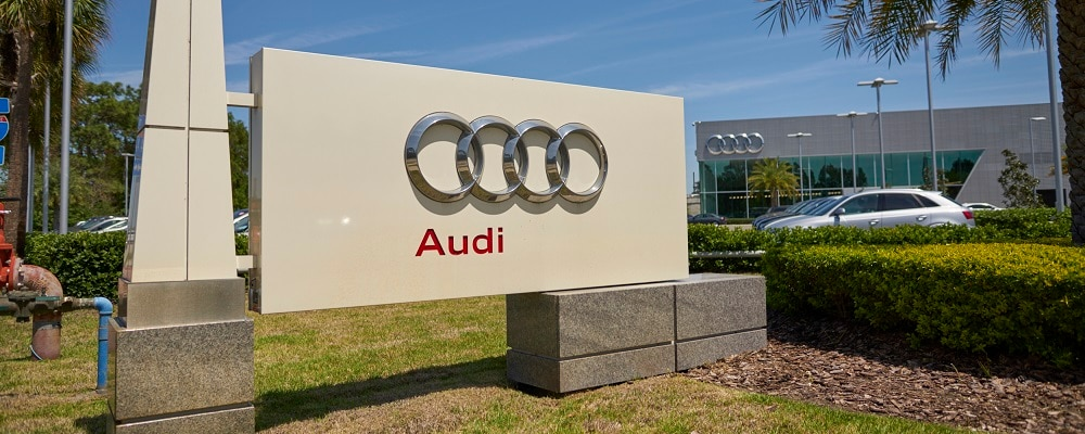 Exterior sign of Audi South Orlando dealership with logo