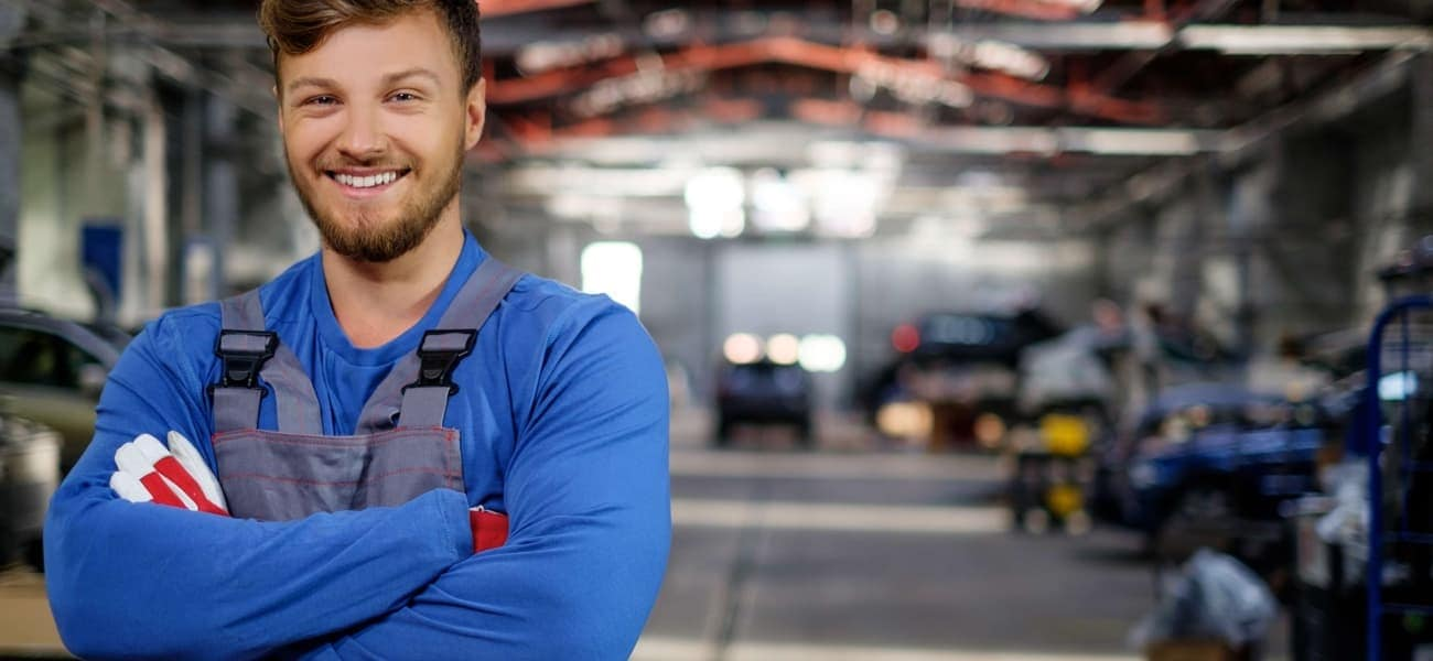 Cheerful serviceman in a car workshop_91820782.jpg