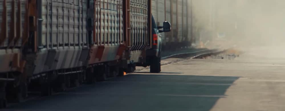 Electric Ford F-150 Towing a Train