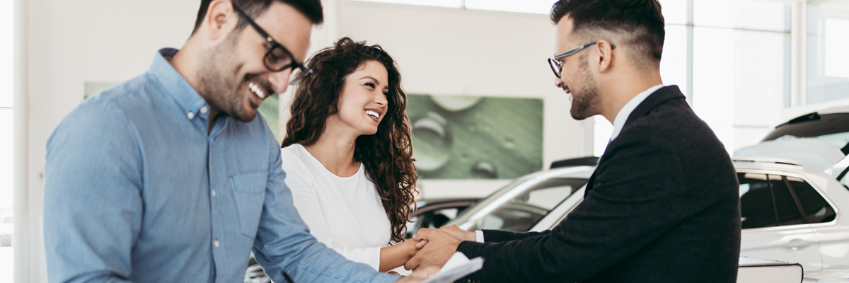 Couple Buying a New Car | Leasing vs Financing Information