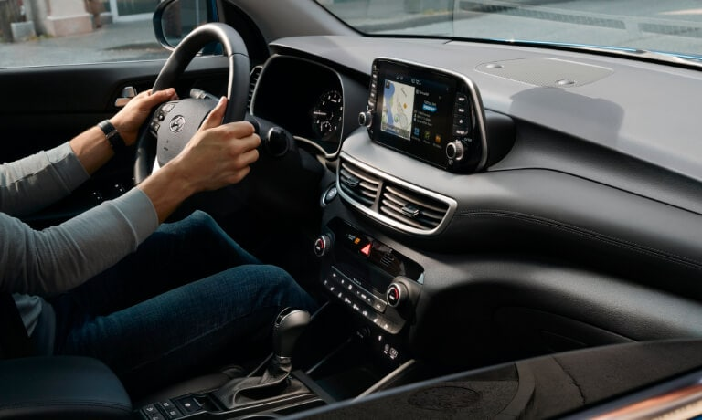 2020 Hyundai Tucson interior view of the front dash showing the touch screen and driver side