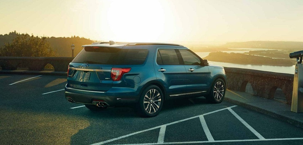 Blue 2018 Ford Explorer rear 3/4 view