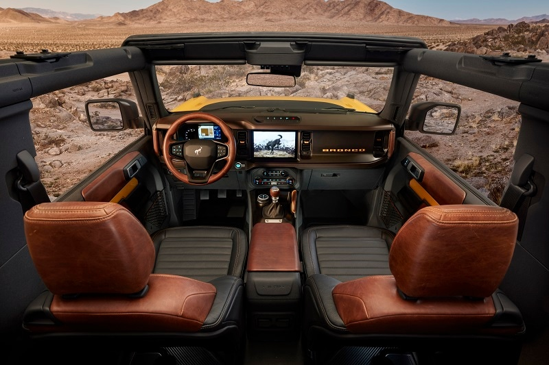 Interior of the Ford Bronco with a view of rugged terrain