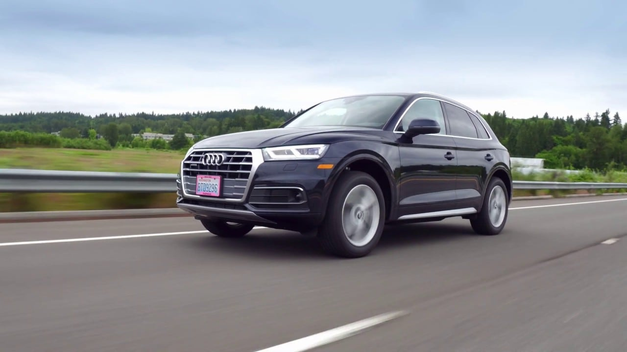 Exterior view of the Audi Q5 driving down the highway
