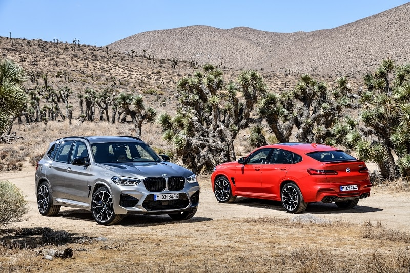 Exterior view of 2021 BMW X3 M and 2021 BMW X4 M