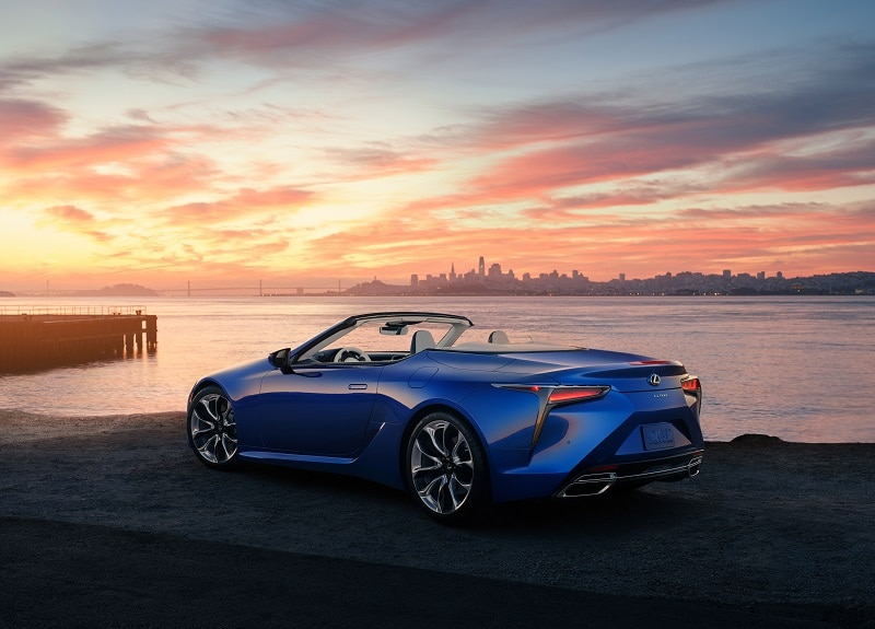 View of the 2021 Lexus LC 500 convertible near a beach at sunset