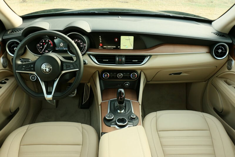 Cream leather and light walnut accents give Stelvio's cabin a premium feel.