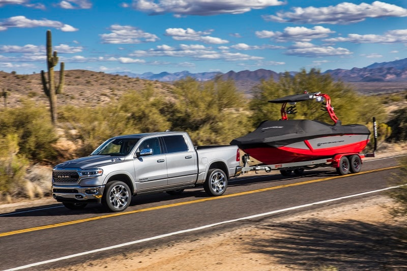 A silver RAM 1500 shows off its towing capacity