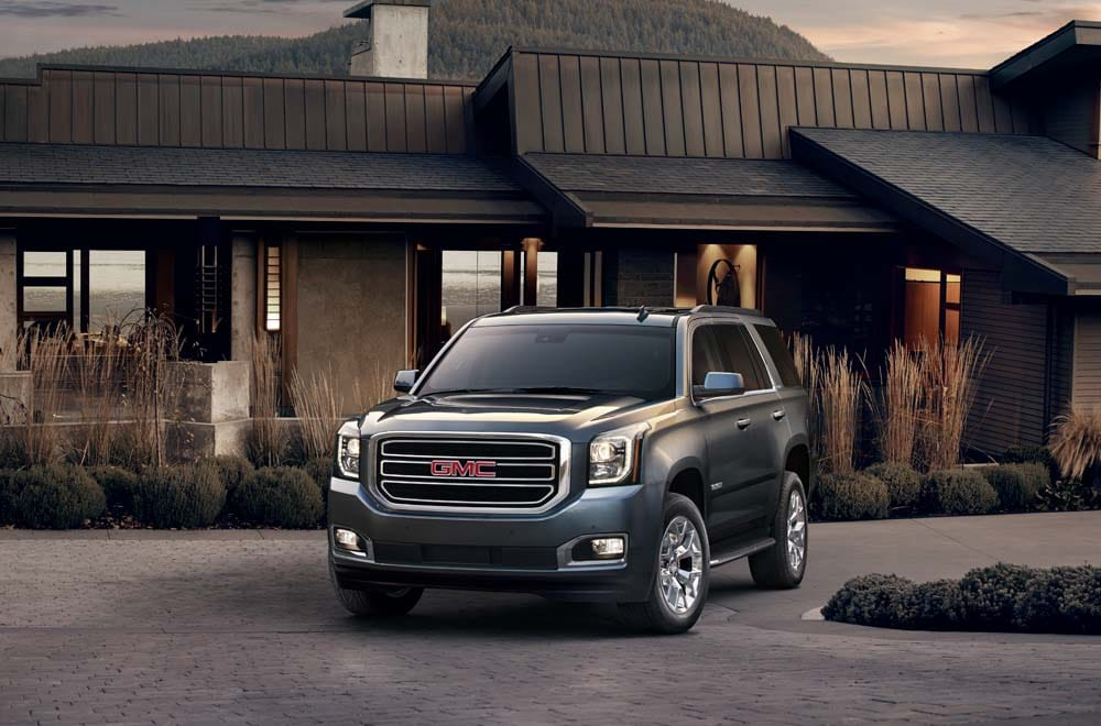 Image of a GMC SUV parked in a driveway