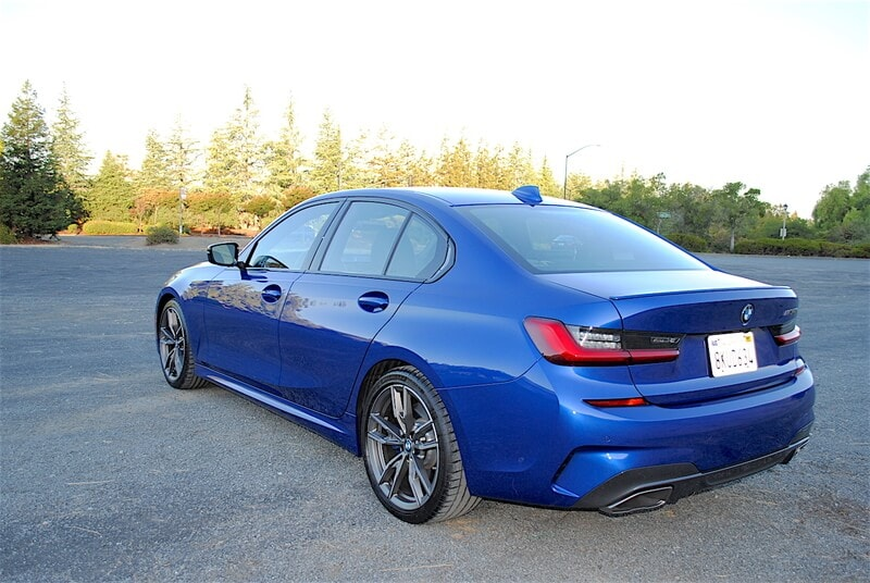 The rear of the M340i features a deck-lid mounted spoiler, twin exhaust tips, and special M340i badging.