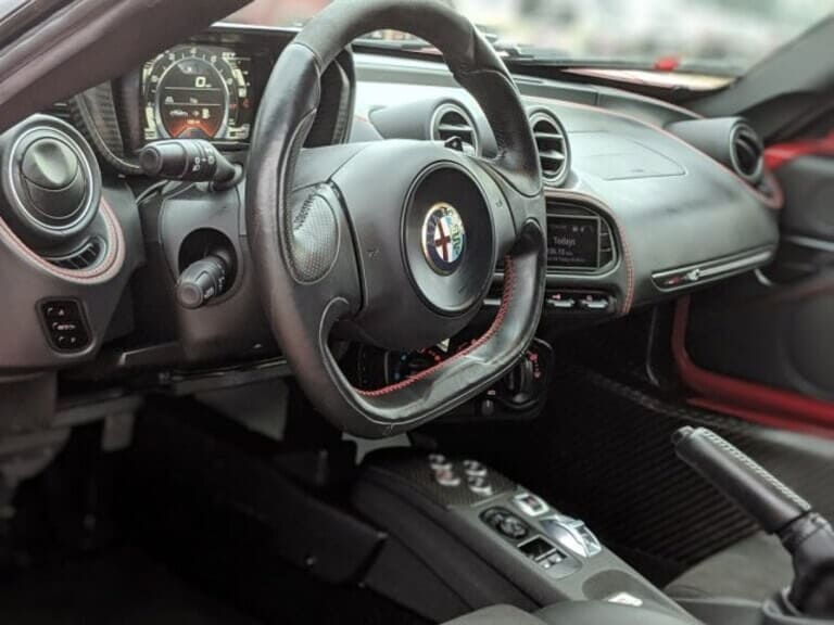 The Alfa Romeo 4C doesn't feature a lot of creature comforts — but there is a cup holder.