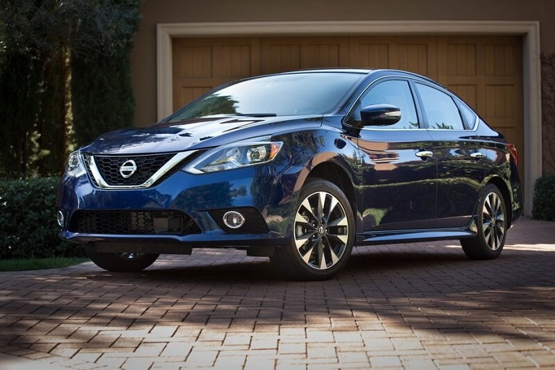 Image of a blue Nissan Sentra in a brick driveway