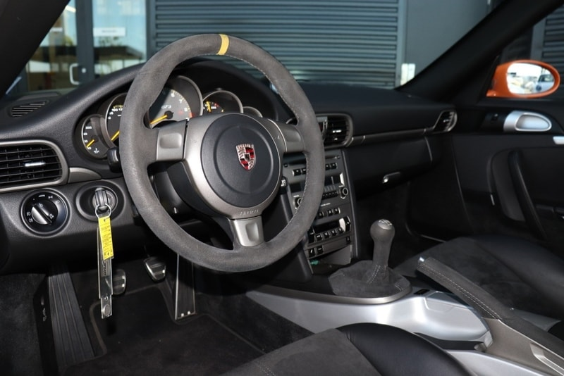 The cabin of GT3 RS is all business. Note the center stripe on the wheel.