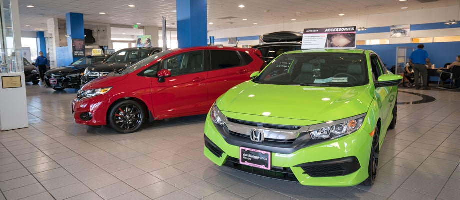 View of two Honda vehicles in Honda model showroom