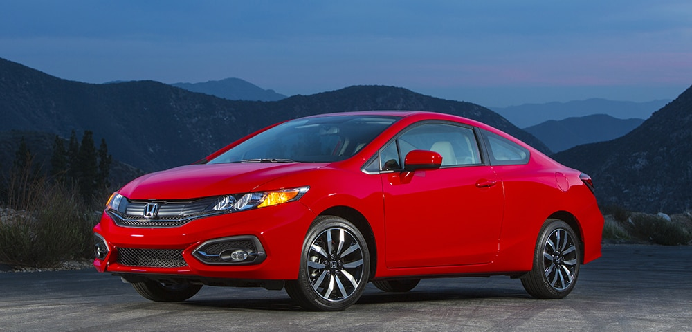 Used 2015 Honda Civic EX with optional fog lights in the foothills at sunset
