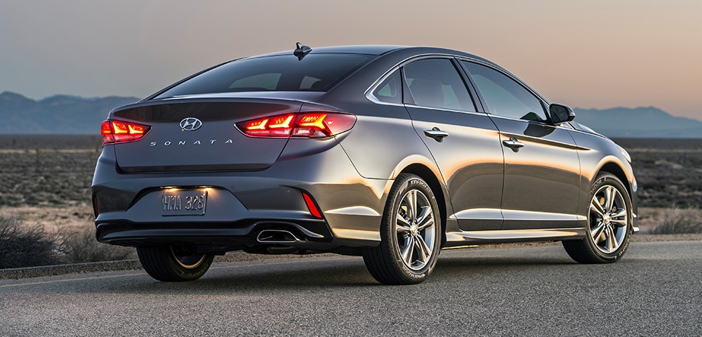 Rear three-quarter view of 2018 Hyundai Sonata in a sunset.