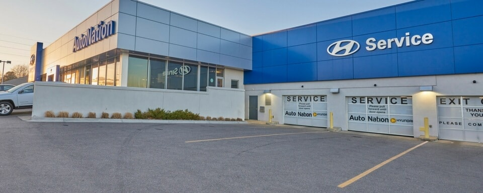 Exterior view of AutoNation Hyundai 104's service center entrance