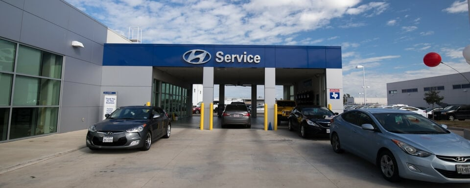 Day shot of AutoNation Hyundai Corpus Christi service center entrance.